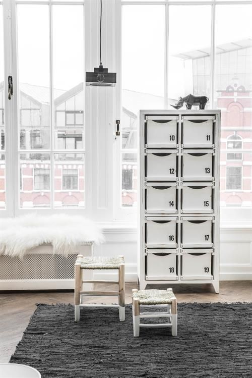Liking these white dipped Moroccan stools – HK LIVING