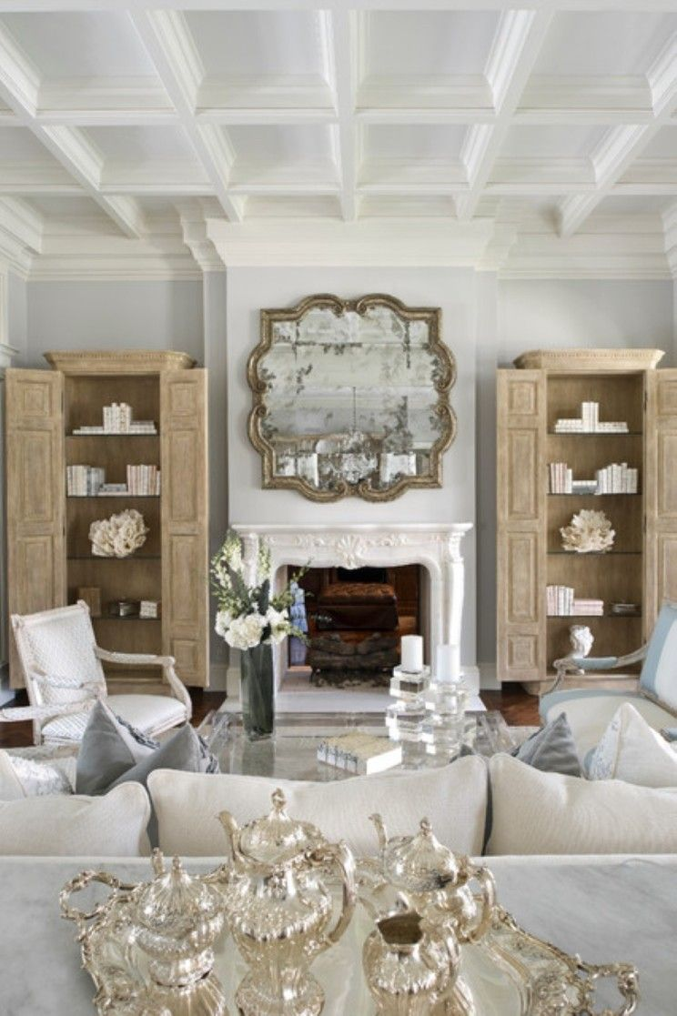Greige wood cabinets used as bookcases and place on each side of a