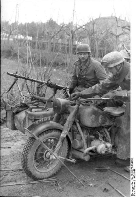 Fallschirmjäger motorcycle riders, either used as dispatch riders or reconnaissance (most likely the former) get ready to take off, 1943/1944. The passenger in the sidecar has an MG-34 mounted for personnel defense.