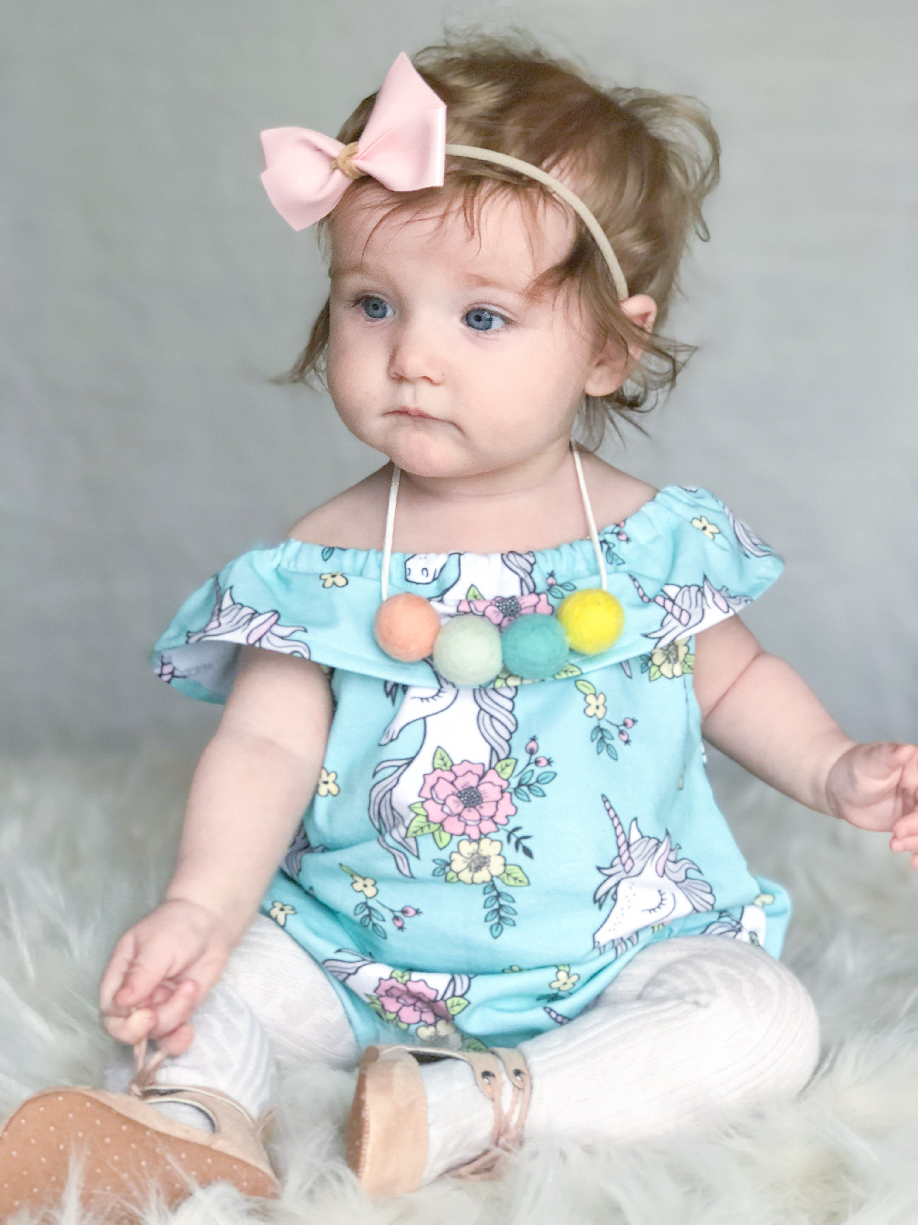 580c4b492 This shoulder ruffle spring romper is great for year round wear! Your little  one will