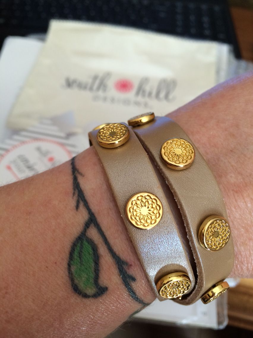 Beige leather wrap with gold studs