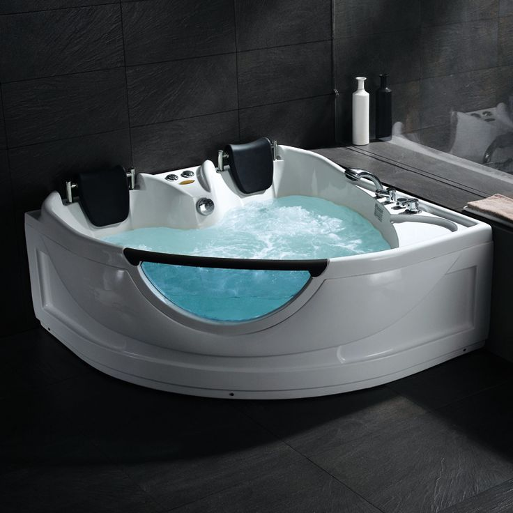 With two seats, this whirlpool bath with pillow cushions has ...