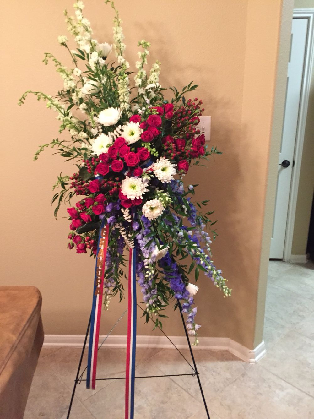 A red white and blue fresh flower standing spray made for a a red white and blue fresh flower standing spray made for a veterans funeral by special day flowers sympathy and funeral flowers pinterest funeral izmirmasajfo