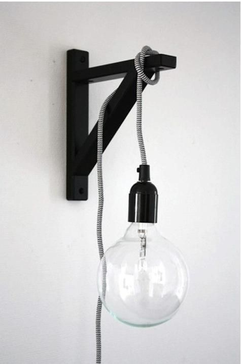 For a space-saving lamp, hang a lightbulb on a cord off of a wall-mounted  shelf bracket. note: this isn't just any old cord and socket or any old  bulb. - For A Space-saving Lamp, Hang A Lightbulb On A Cord Off Of A Wall