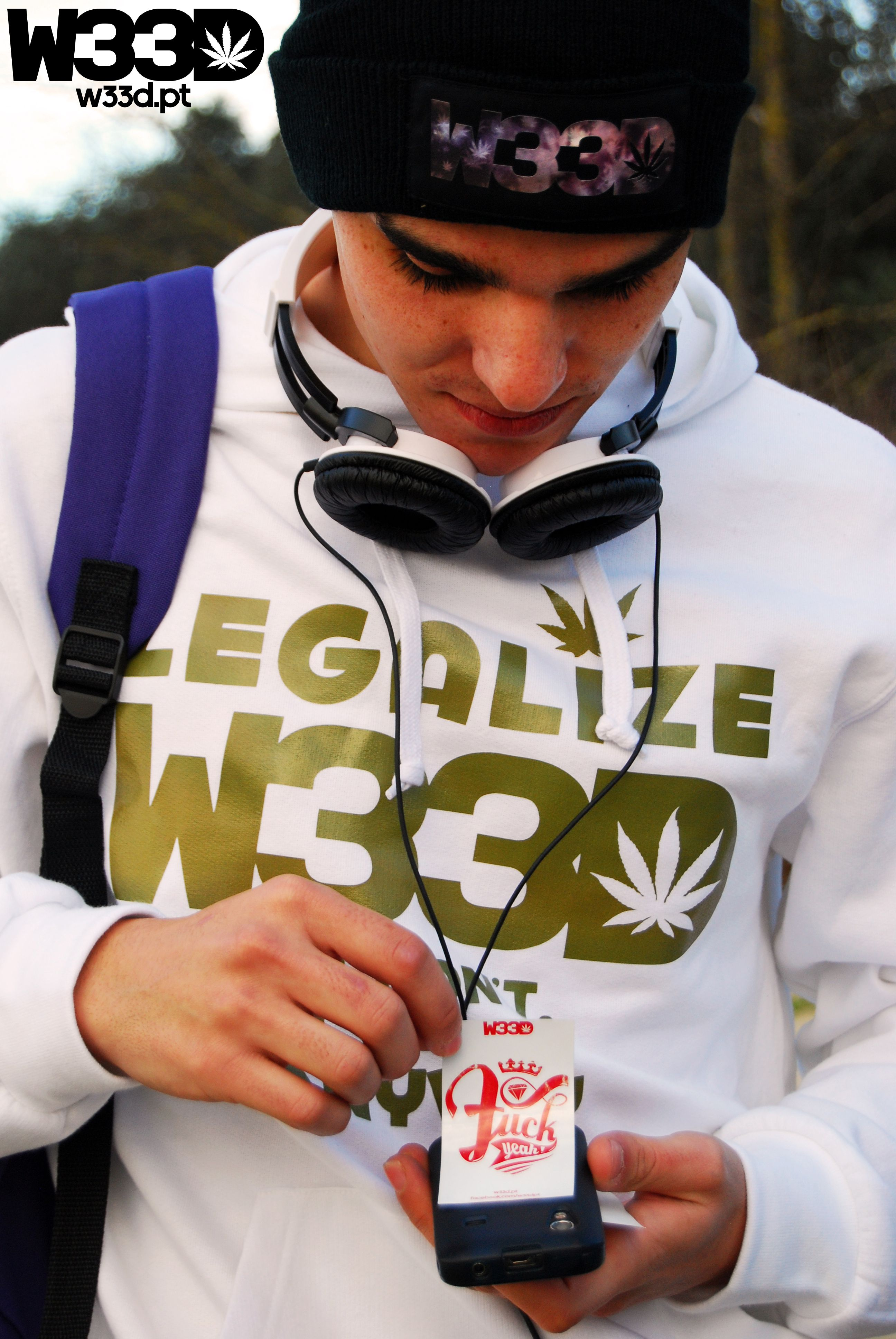 Our model with one of the #W33D stickers we offer with every order.