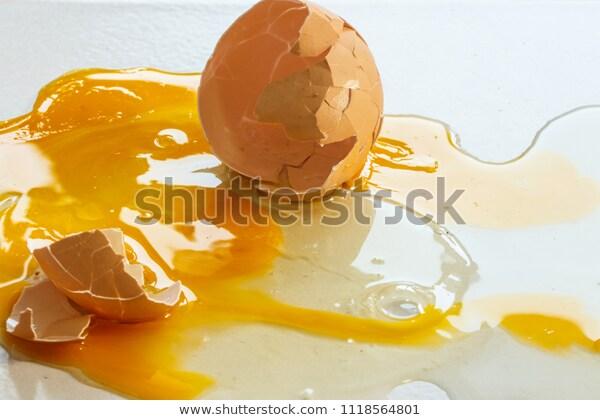 Broken Egg On White Floor Stock Photo Edit Now 1118564801 Broken Egg White Floors Stock Photos