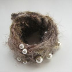 Stay warm this winter! Wearing a cuff (and a necklace) made of wool and pearls to add some sparkle ...