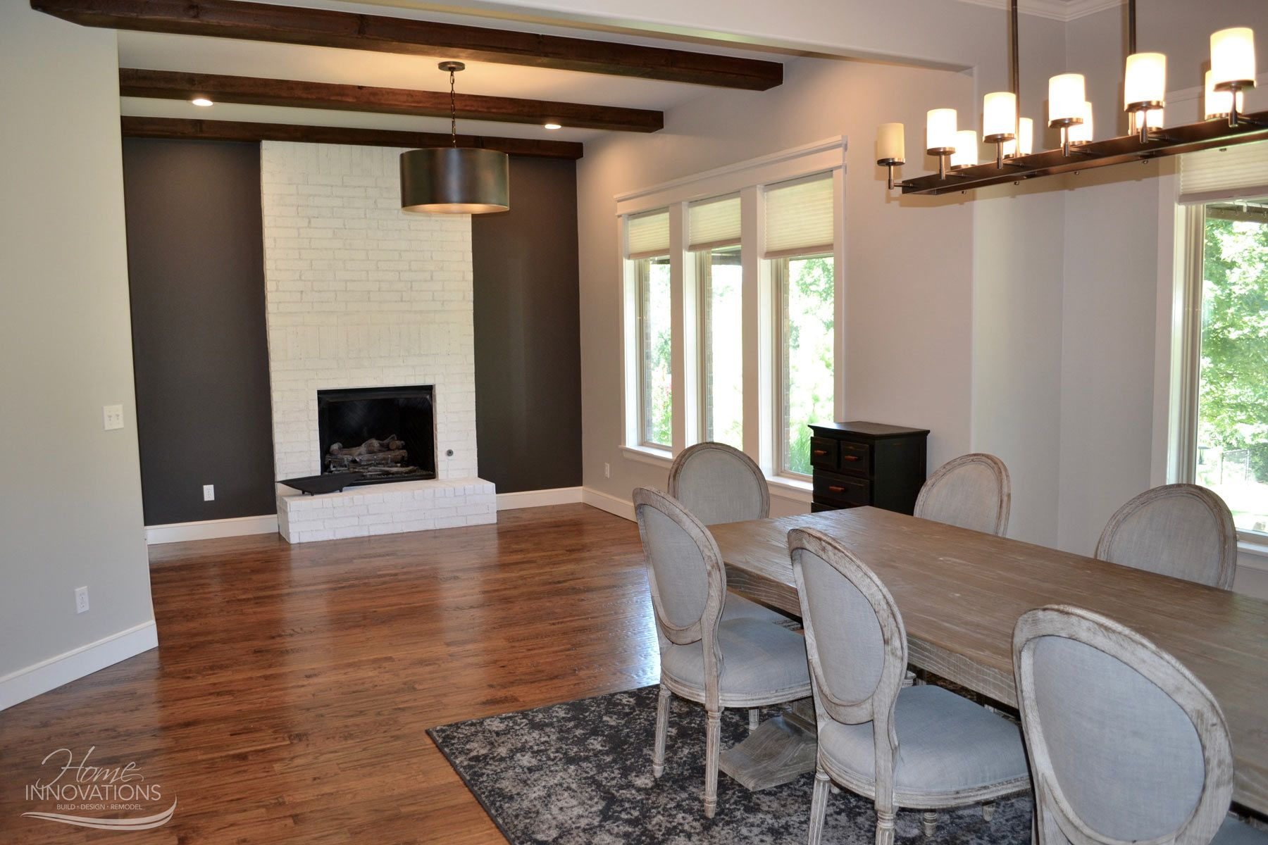 Breakfast nook remodel with painted fireplace dark gray accent wall