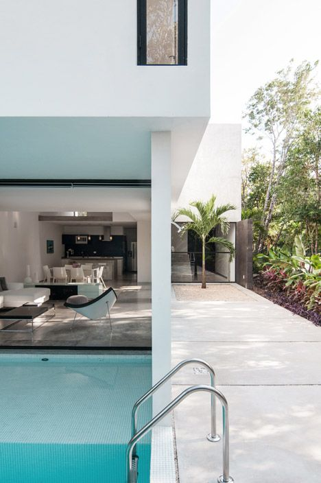 This Mexican house features an open layout and a pool.