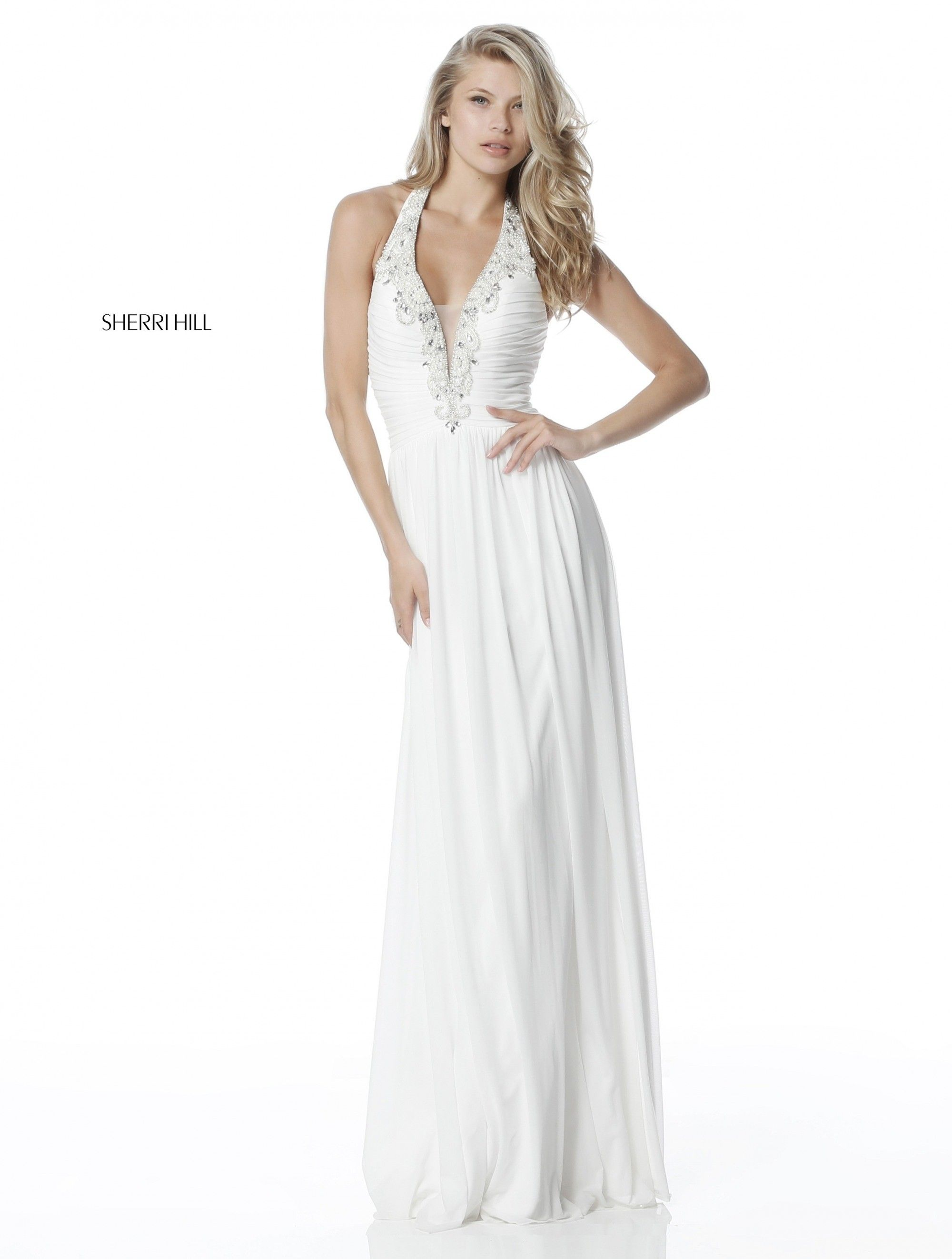 f28582c93c0 Treasure the romance of Sherri Hill 51552. This ethereal gown has a ruched  halter bodice