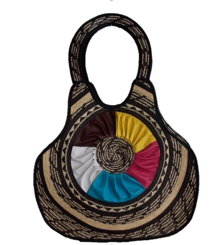 HAND-BAG MADE FROM WOVEN ARROW CANE WITH DESIGNS IN SYNTHETIC LEATHER