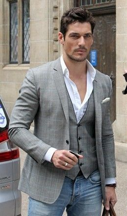 David Gandy. Suit coat and vest with open neck white shirt