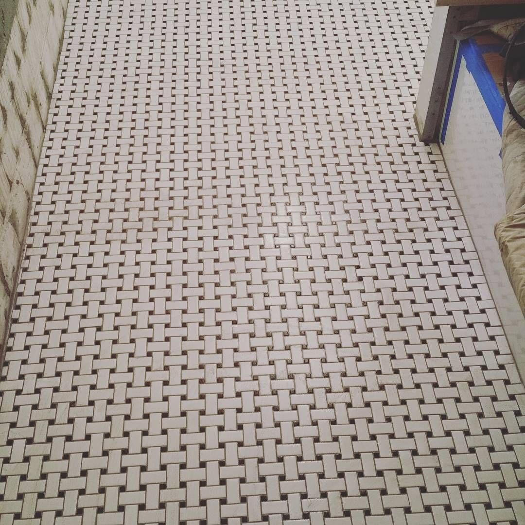 Basket weave mosaic tile floor. We install this on full