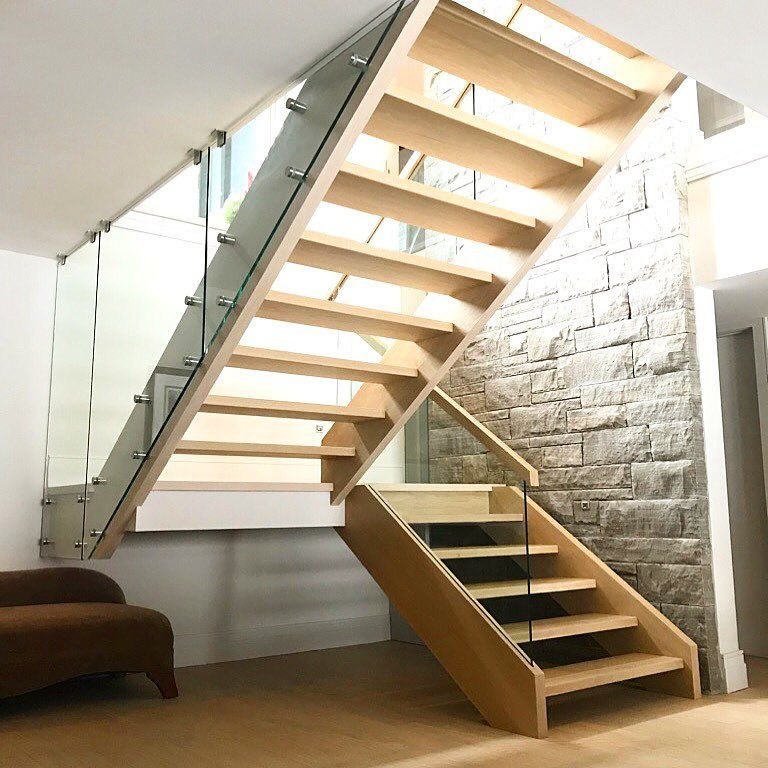 Closed 2 side white oak stairs with built in glass channel