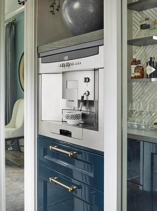 Contemporary Kitchen Nook Showcases A Built In Thermador Coffee Machine  Mounted Above Glossy Blue Shaker