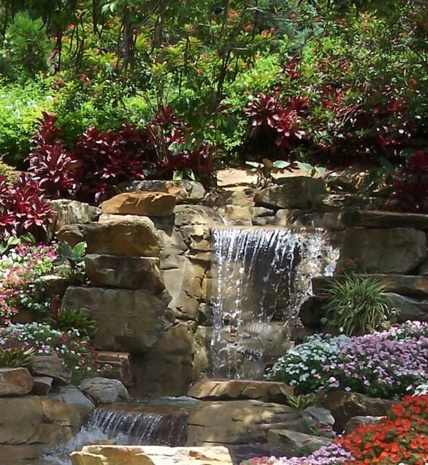 Best 25 outdoor waterfalls ideas on pinterest diy for Pictures of backyard waterfalls