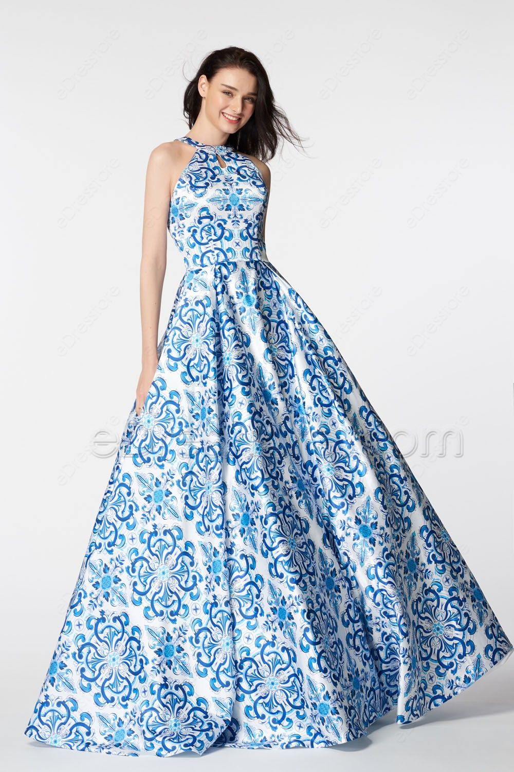 aed4a64fe5d0 The blue printed prom dress features O neckline