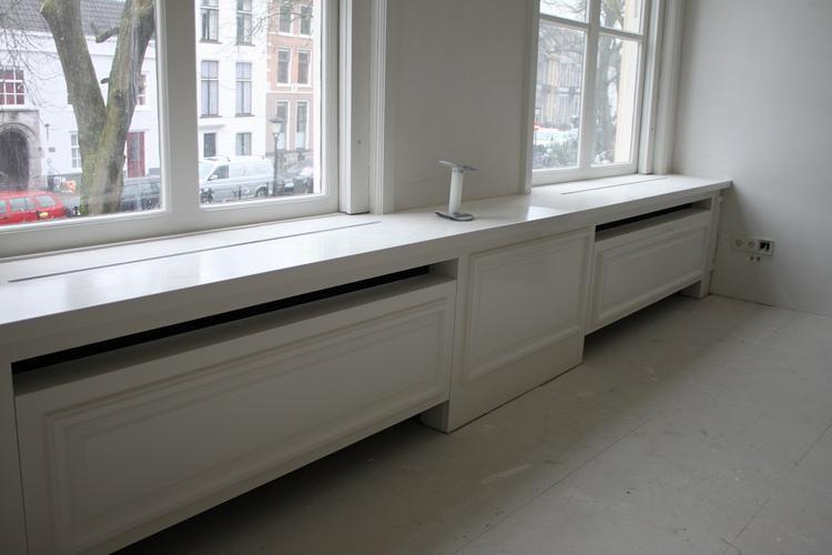 In de woonkamer wil ik een radiator ombouw laten maken. Ik heb 2 ...