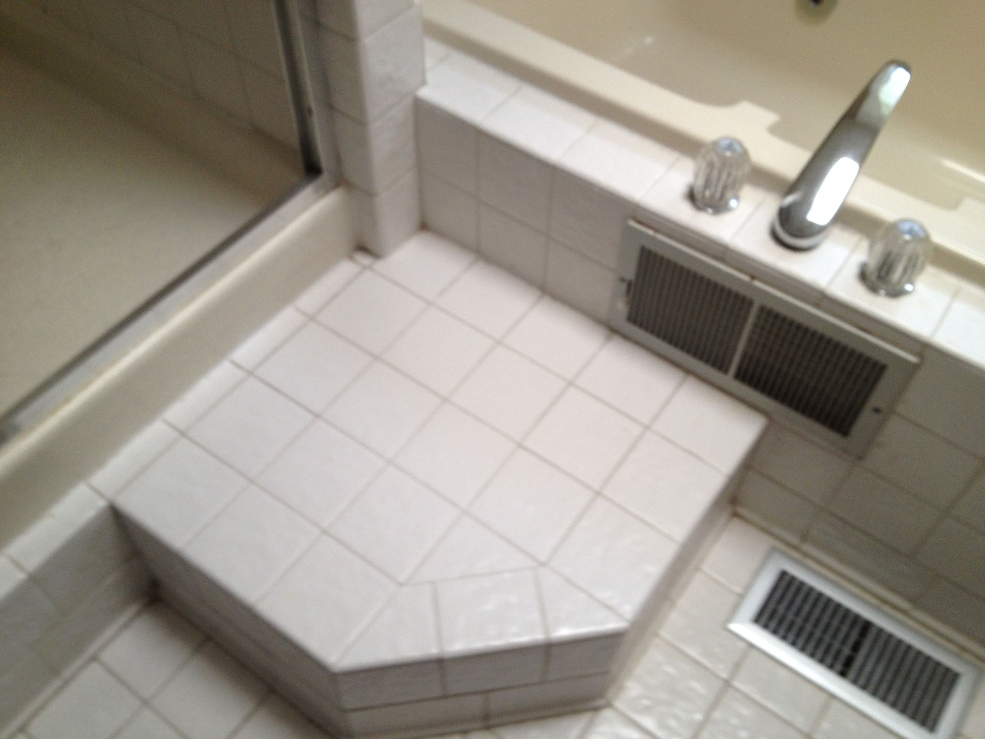 Step up into shower or step over into whirlpool tub. Questionable ...