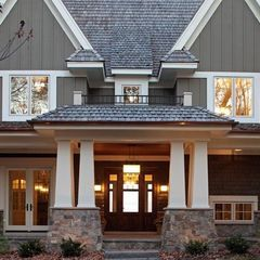 Love the dark taupe board and batten siding, with the barely off white soffet and fascia, craftsman tapered columns and the stone.  All it needs is some stained or colored shutters! Traditional exterior by Stonewood, LLC