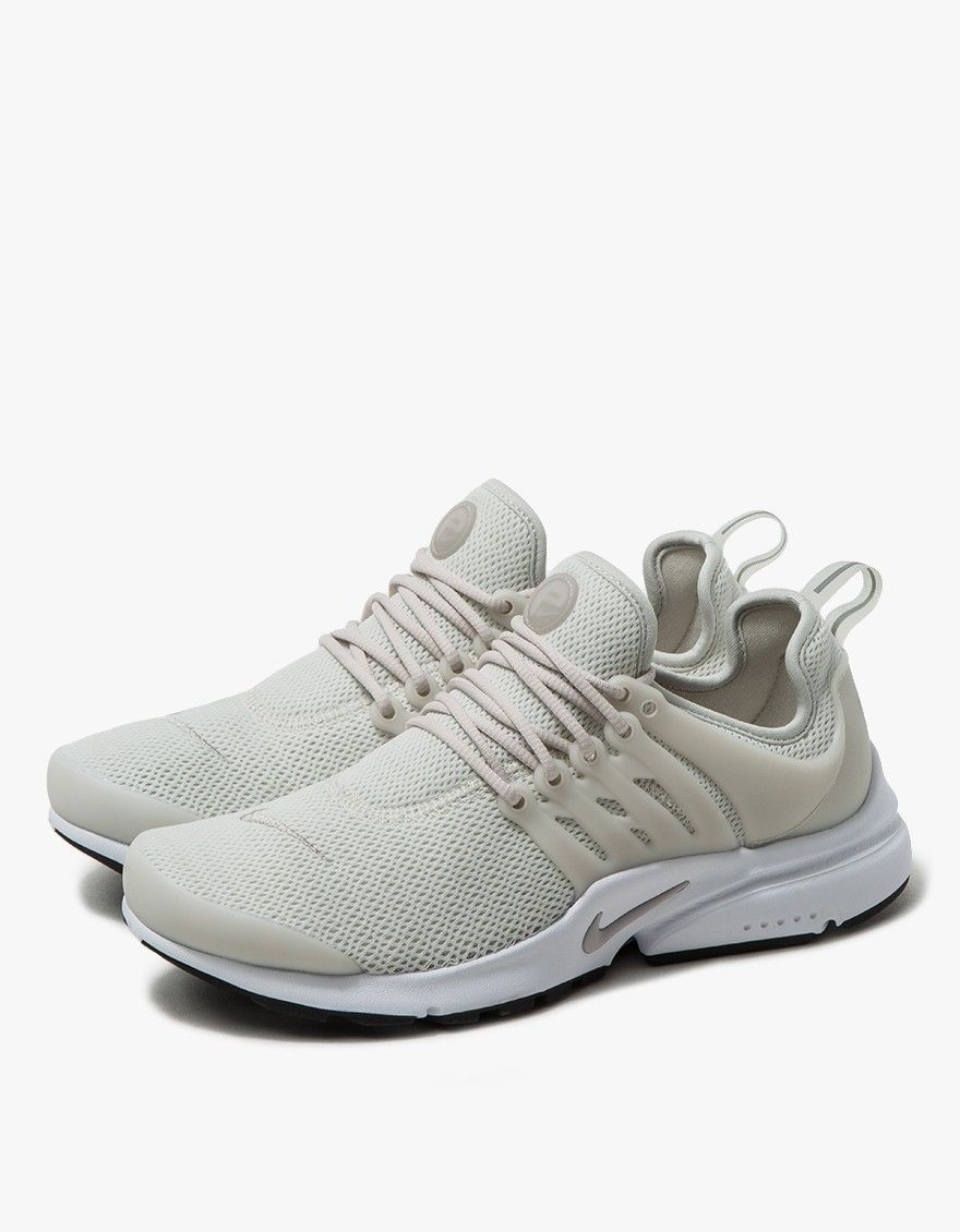 From Nike, a modern runner in Light Bone. Lace-up front. One
