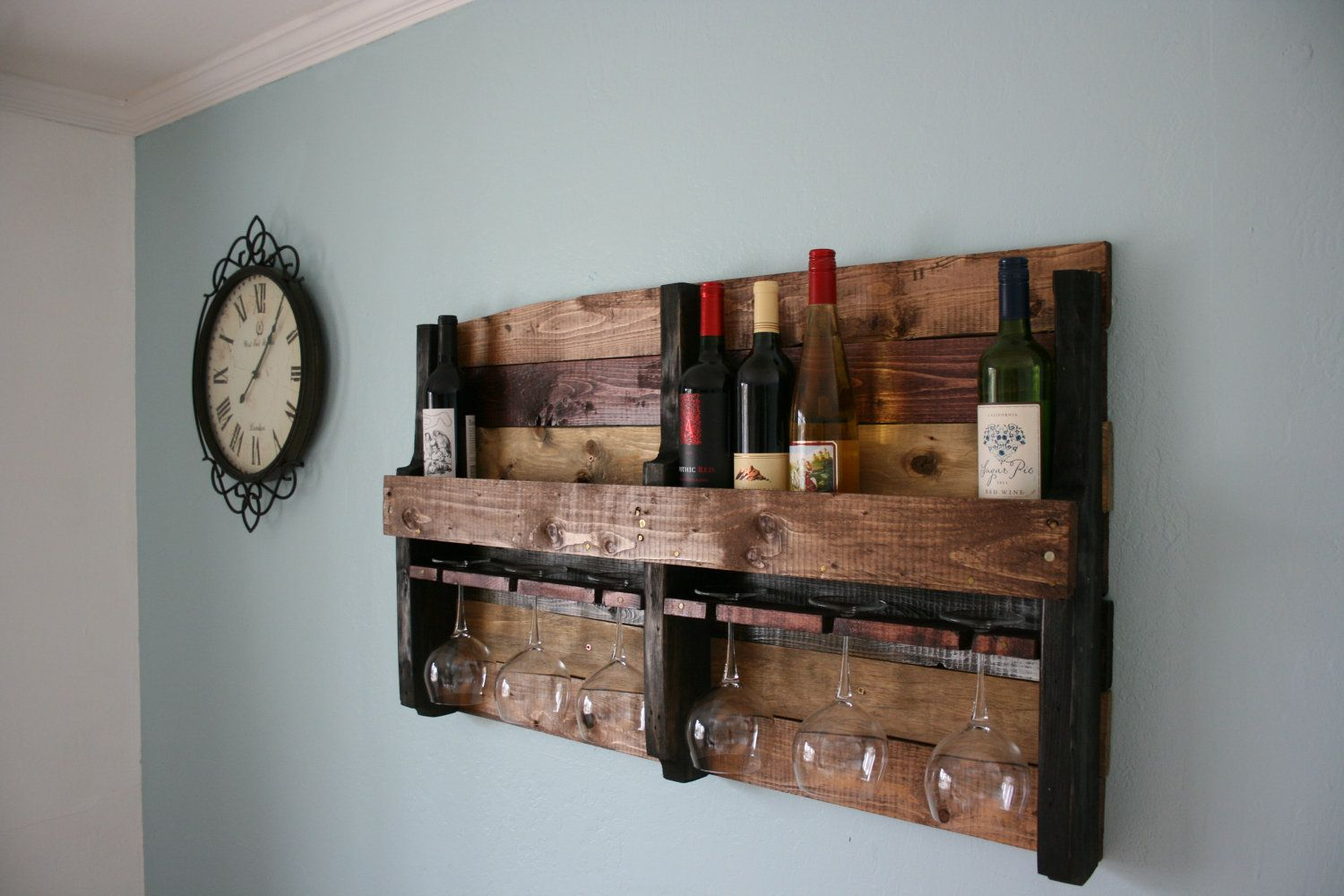 Rustic Wine Rack made from reclaimed pallet wood. $105.00, via Etsy.