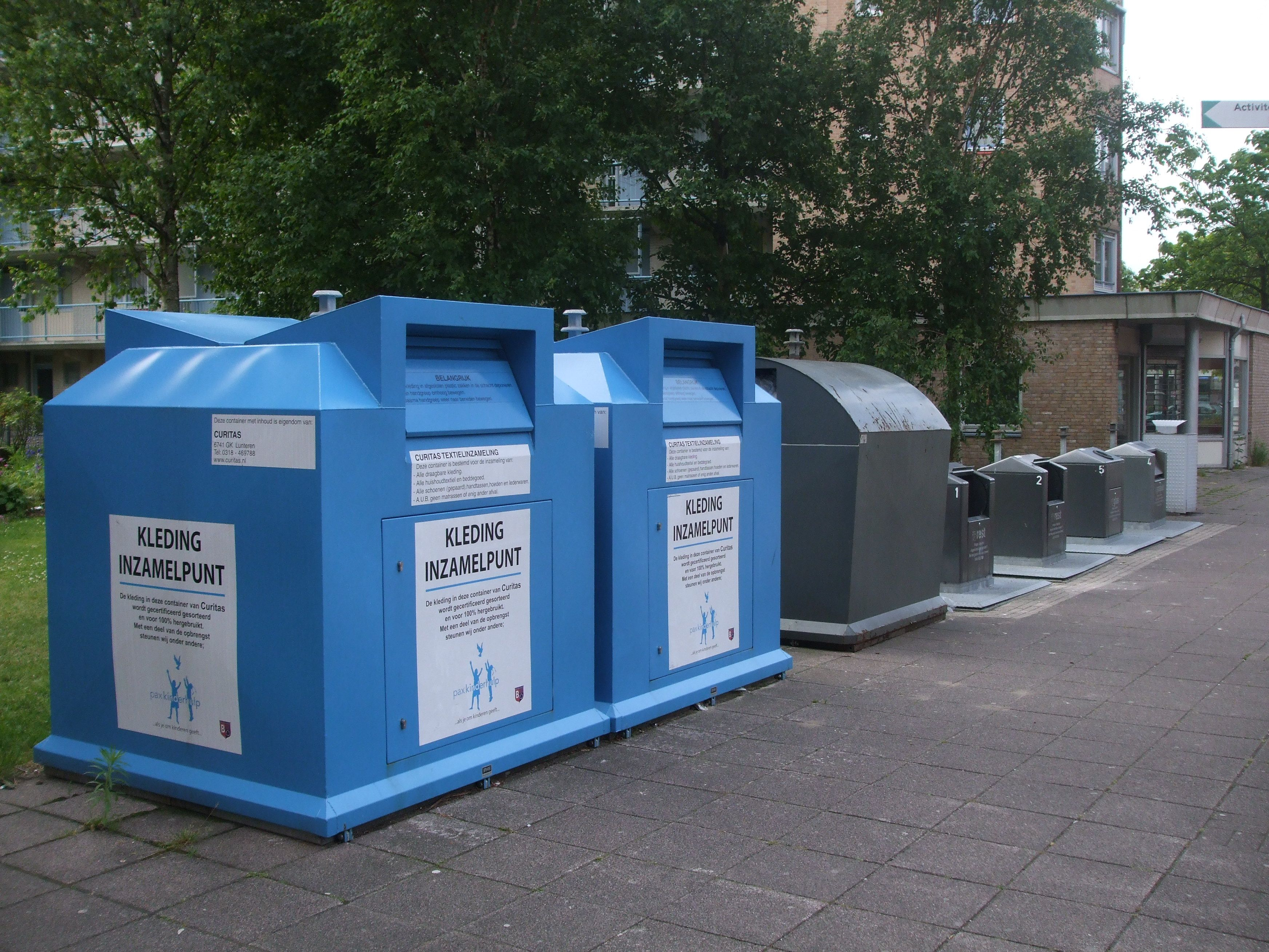 public waste bins on a row for recycling... blue | waste and waste ...