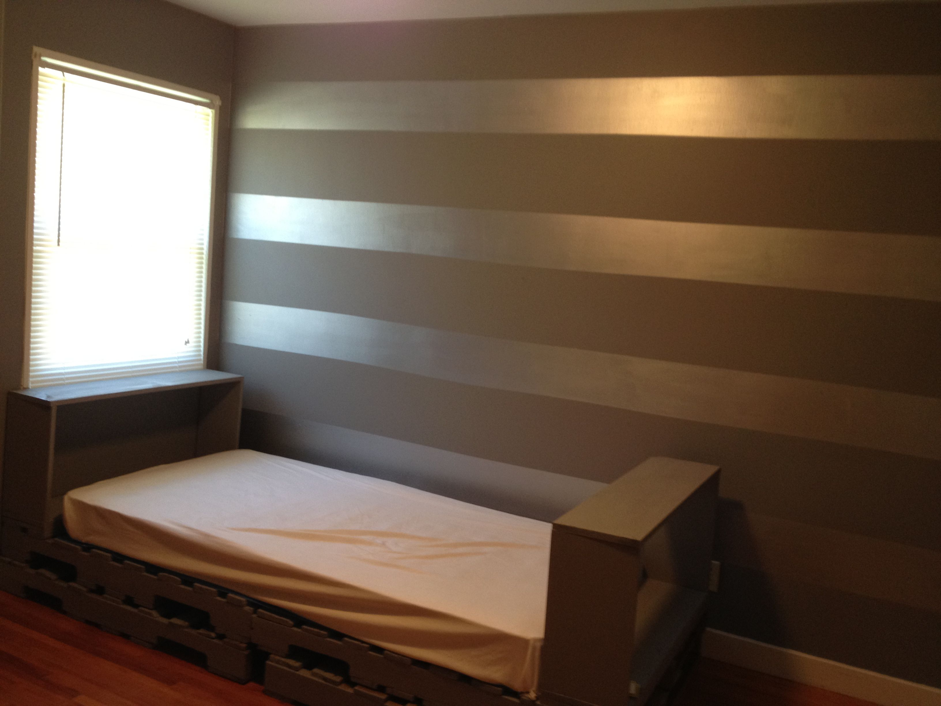 Copper Accent Wall Pallet Day Bed And Metallic Striped Walls For The