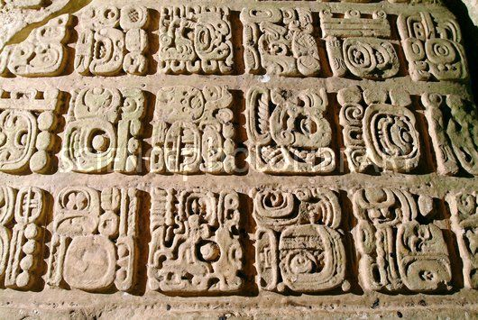 Mayan stone carving close up of glyphs on a stele carved