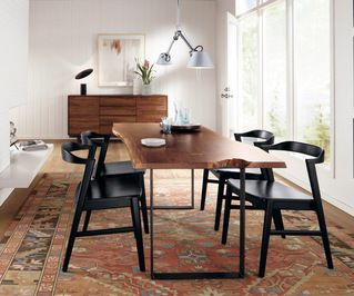 modern dining area featuring a reclaimed wooden table mod black dining chairs white shiplap