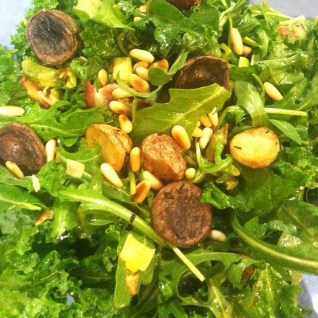 Salad w baby arugula and kale w roasted asparagus, leeks, bacon bits, pinenuts, roasted baby potatoes w lemony vinegrette.