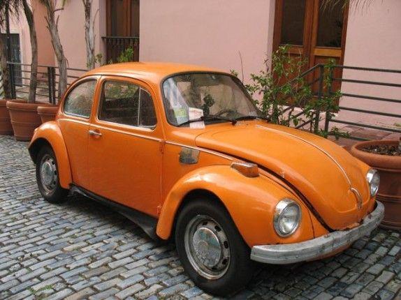 a vintage orange volkswagen beetle this was our mode of transportation through germany great. Black Bedroom Furniture Sets. Home Design Ideas