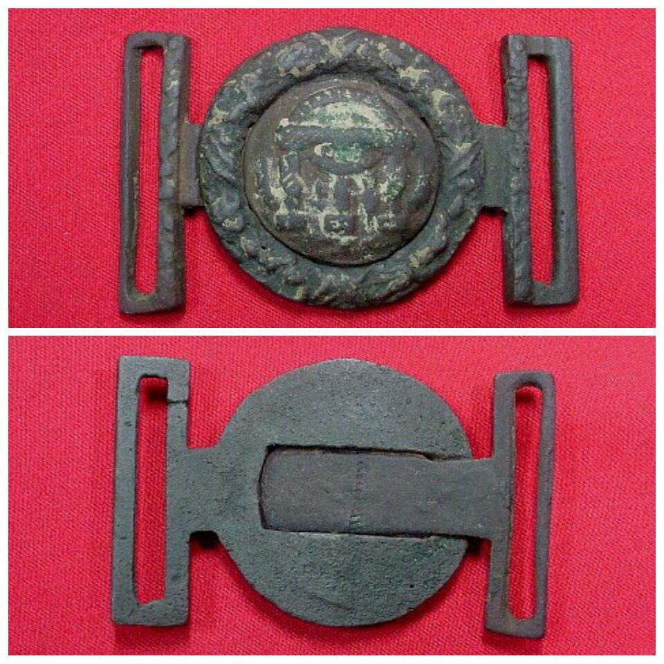 An extremely rare to recover Confederate Local, 2-piece, Georgia State Seal tongue and wreath sword belt plate.  This plate was recovered on private property near Orchard Knob at the base of Missionary Ridge, Tennessee.  It is out of the personal collection of Civil War author, Charlie Harris.  Very few Confederate buckle collections include this rare CS Local Georgia 2-piece State Seal.  It is the patterned plate with decorated inner loop on both the tongue and wreath.