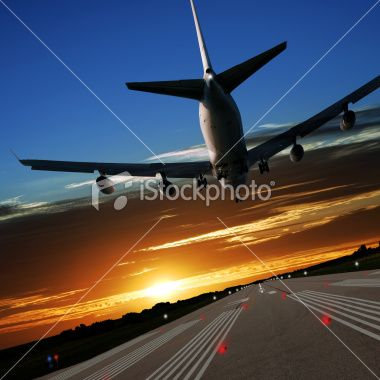 Dramatic airliner landing into the sunset