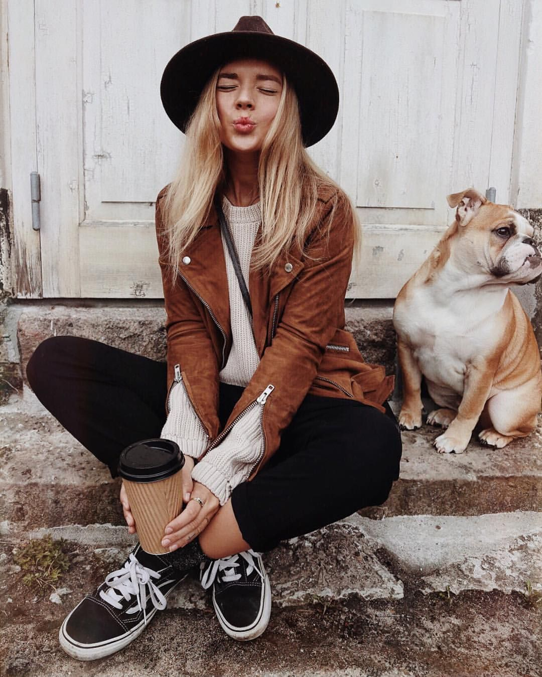 b6a906e4a49 black skinnies + sweater + brown leather jacket + sneakers + crossbody +  floppy hat