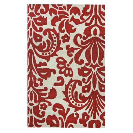 Create a regal flourish in your foyer, living room, or master suite with this artfully hand-tufted rug, showcasing and oversized damask motif in red.