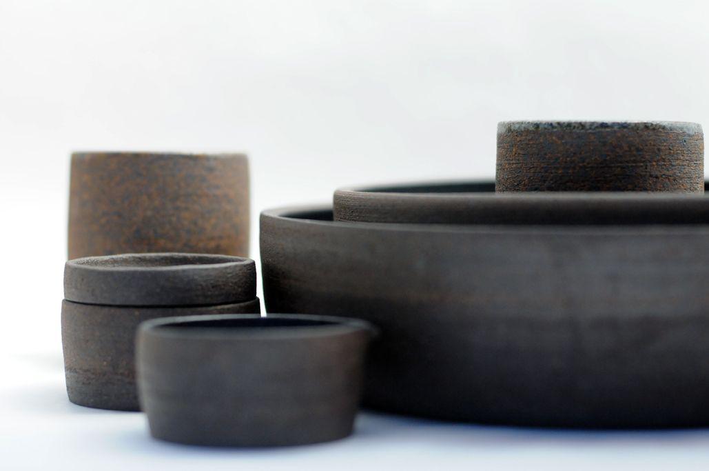 dark stoneware, unglazed exterior.  by miro chun