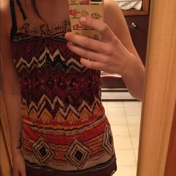 Forever 21 tank top small tribal Forever 21 tank top flowy size small. Tribal pattern. Shades of orange and brown. Never worn Forever 21 Tops Tank Tops