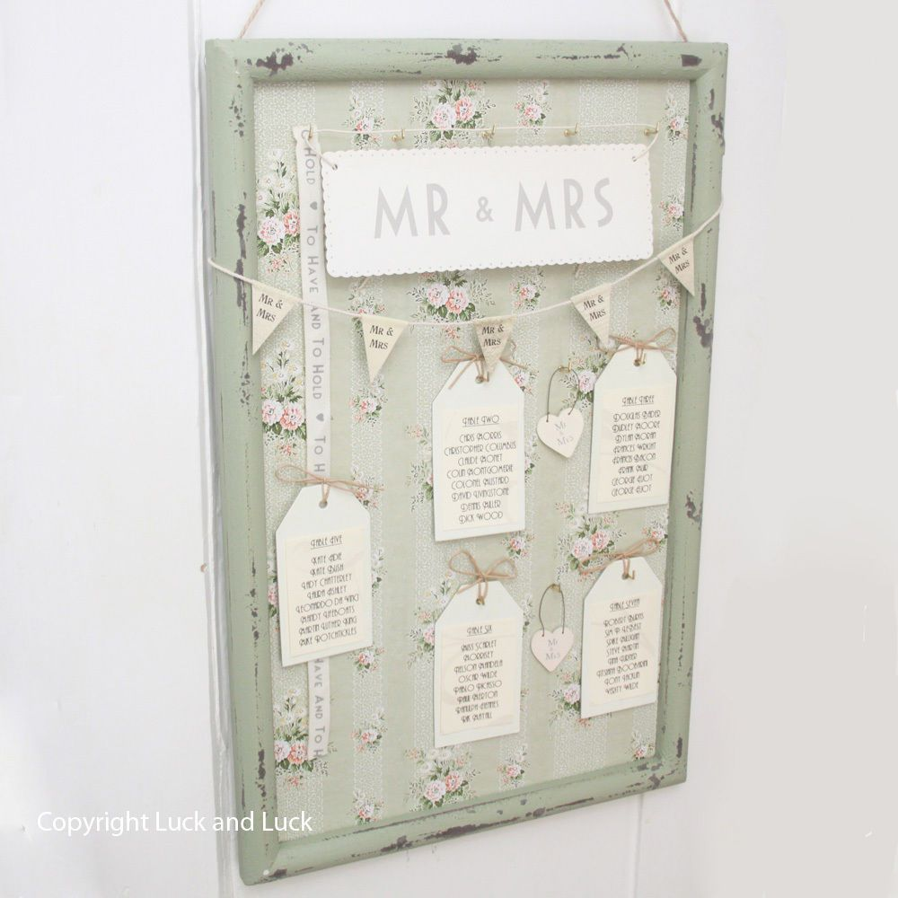 Vintage style green floral frame for wedding table plan idea