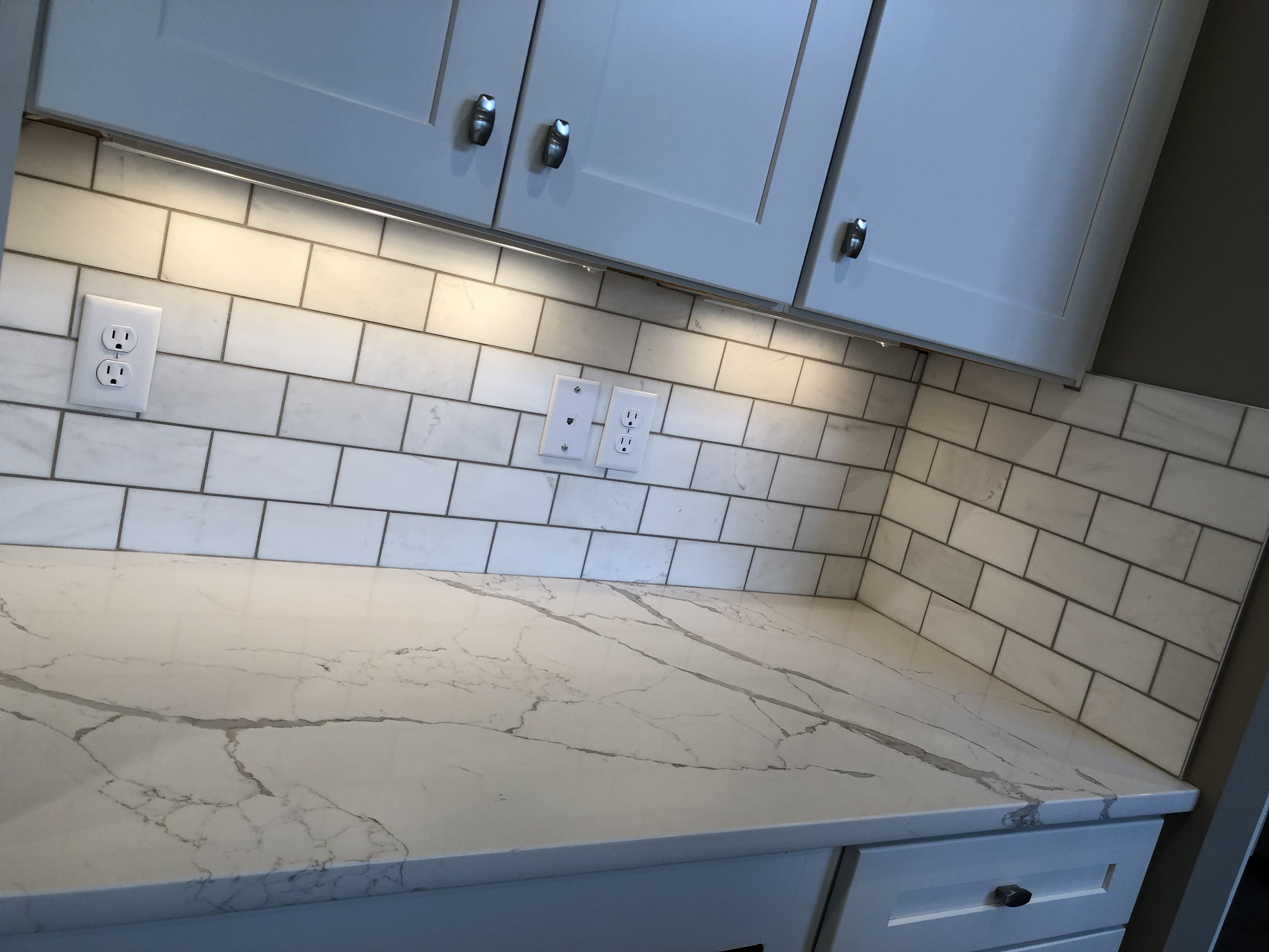 - MARBLE, 3X6, CONTEMPO WHITE, HONED, INSTALLED BRICK JOINT WITH