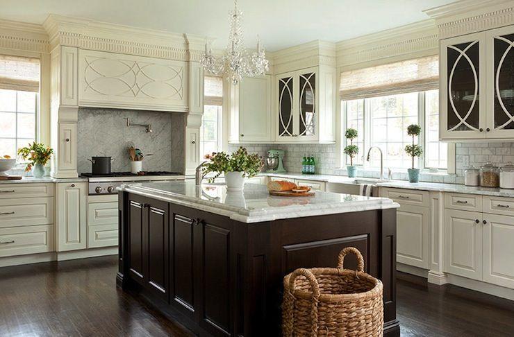 kitchens - ivory kitchen cabinets espresso stained kitchen island beveled marble countertops farmhouse sink marble subway tiles slab backsplash