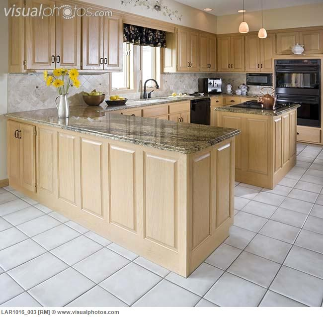 Kitchen With Light Maple Cabinets And White Tile Floor