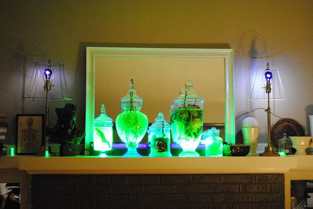 Highlighter glows in black light so just open and put into jar with - halloween office decorating ideas