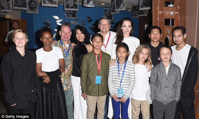 A family affair: The star made it a family affair, as she brought along each of her six children. (L-R) Shiloh, Zahara, Vivienne, Pax , Knox and Maddox Jolie-Pitt along with Peter Sellars, Loung Ung, Kimhak Mun, Ted Sarandos, Sareum Srey Moch