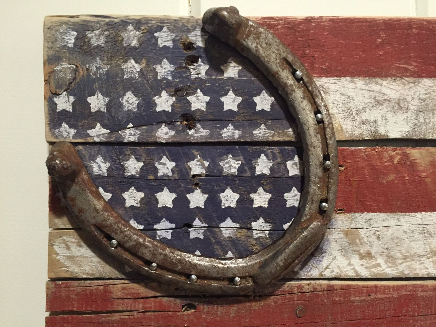 Items similar to Rustic American flag made out of old pallet wood with horseshoe on Etsy