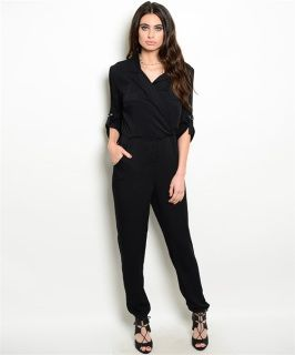 Black long sleeve jumpsuit. Woven jumpsuit features a button up bodice, hidden pockets and dropped inseam. Fabric Content: 100% RAYON