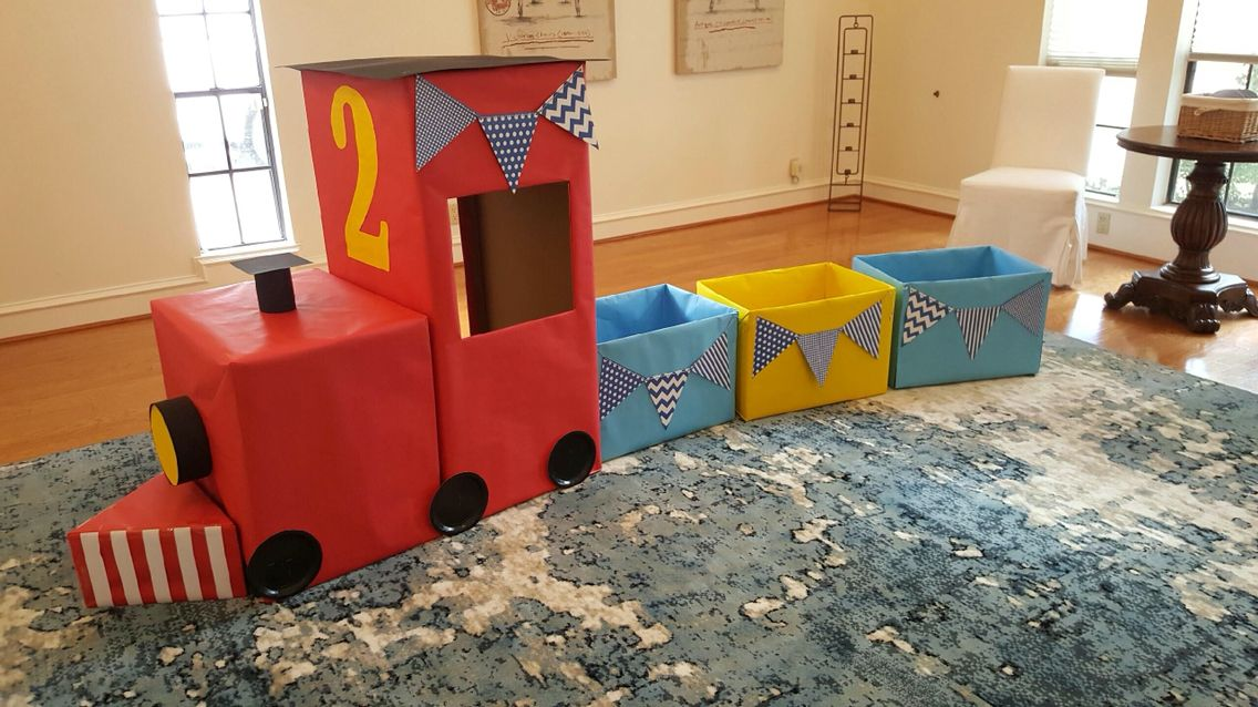 DIY train for my son's 2nd birthday!  Made from boxes and craft paper.  Chugga chugga two-two!