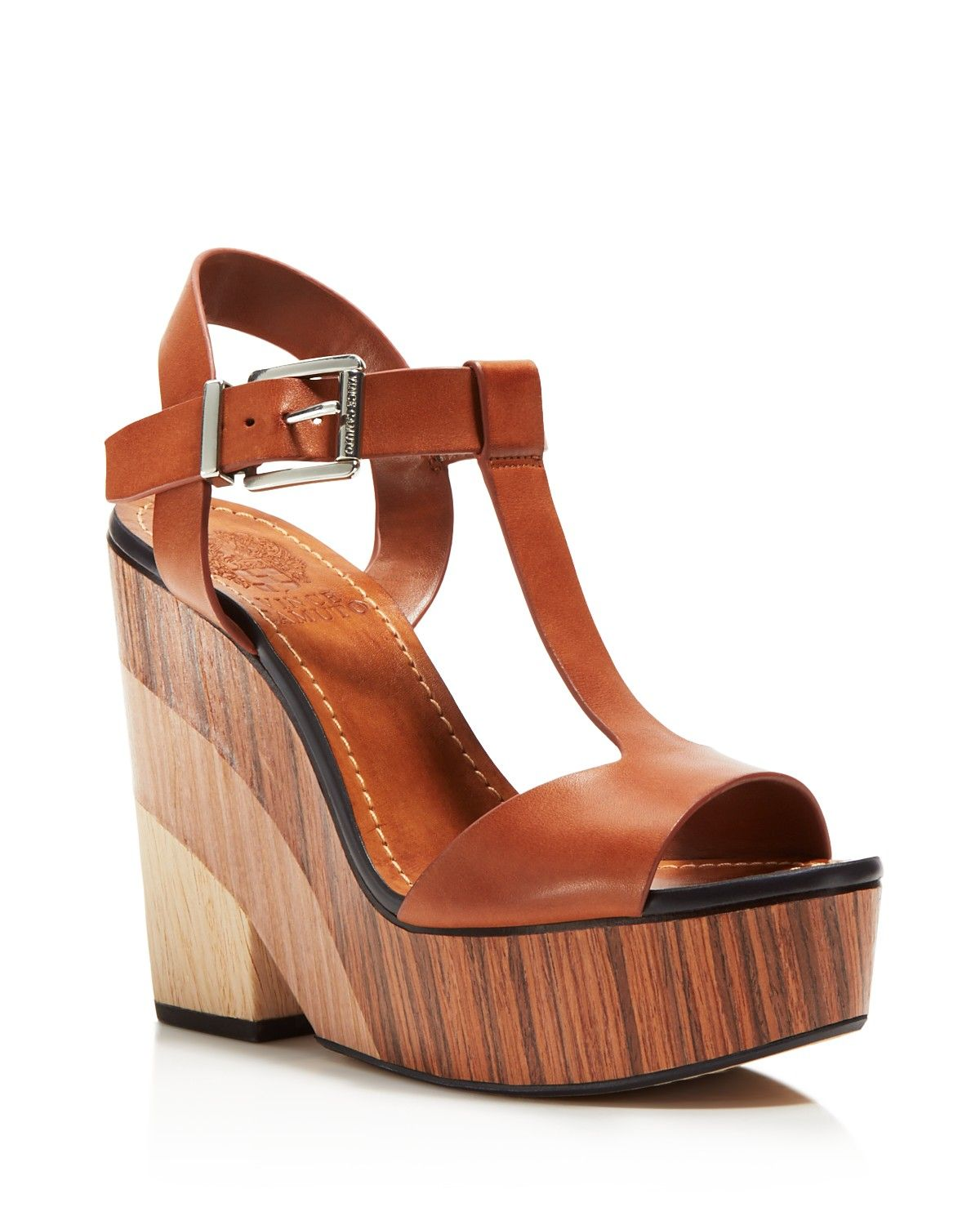 b160292bf9 VINCE CAMUTO channels retro '70s style in our exclusive leg-lengthening  Oriana T-strap sandal, set on a gravity-defying wood-effect heel.