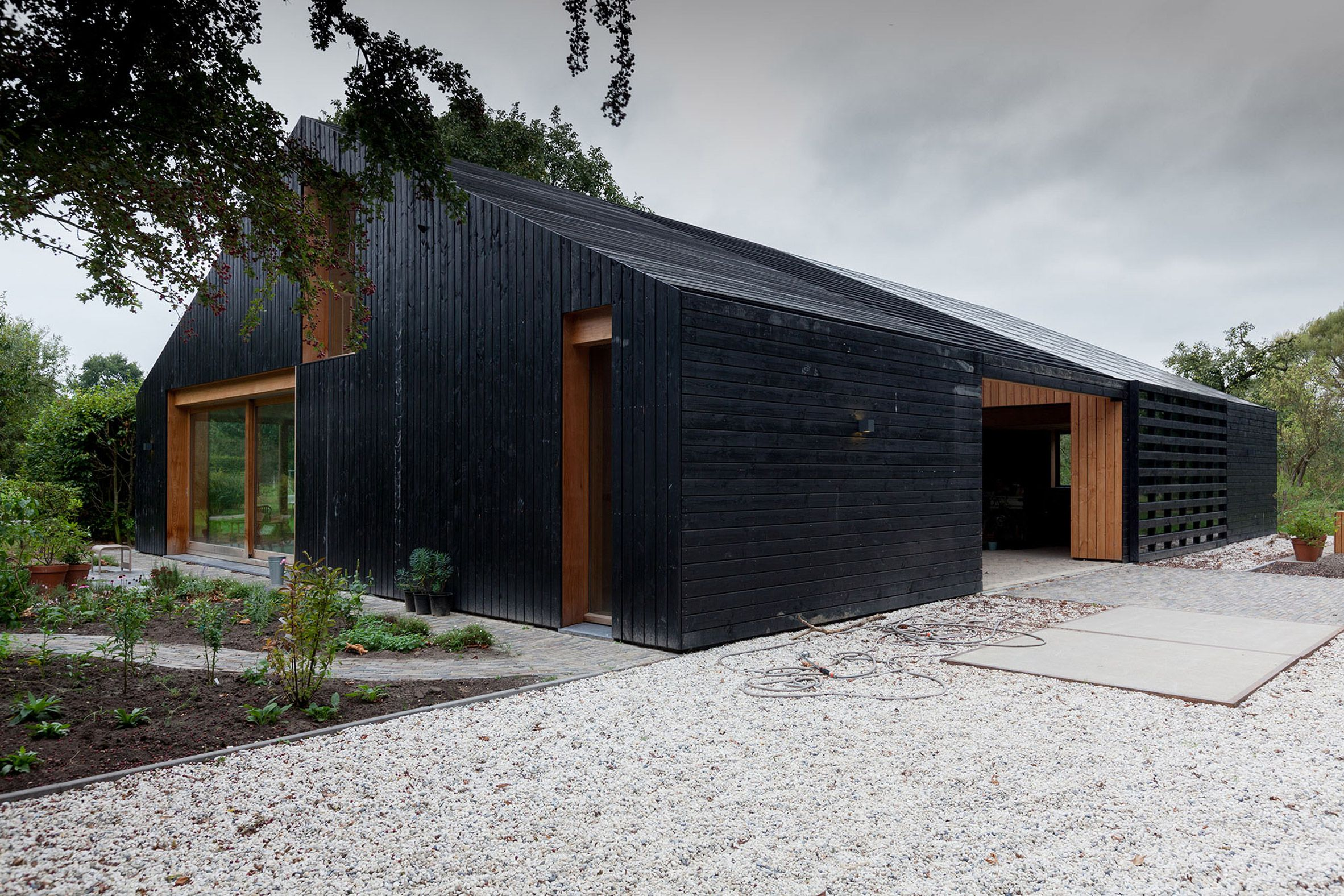Contemporary Barn With A Blackened Exterior By Workshop Architecten Modern Barn Modern Barn House Architecture