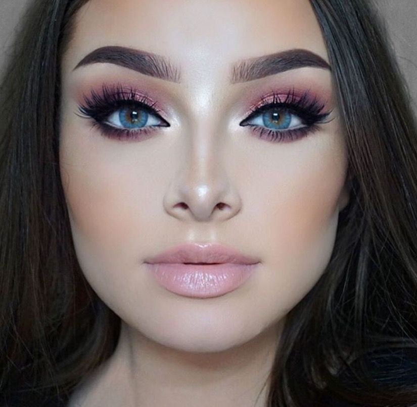 Pink eyeshadow. Her lips are perfect also, the bottom lip is always suppose to be fuller than the Top Lip